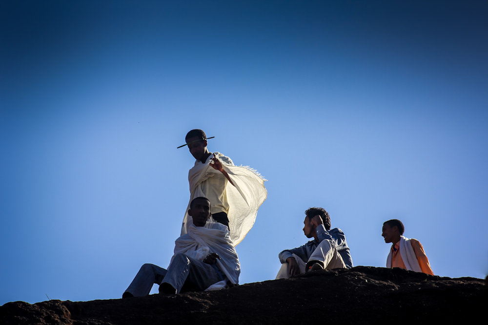 Followers of the Ethiopian Orthodox tradition overlook a ceremony at St. George Church in Lalibela the week before Easter