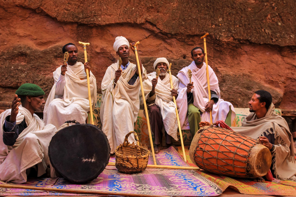 DEACONS      perform traditional music in front of the Beta Emmanuel Church in Lalibela the week before Easter