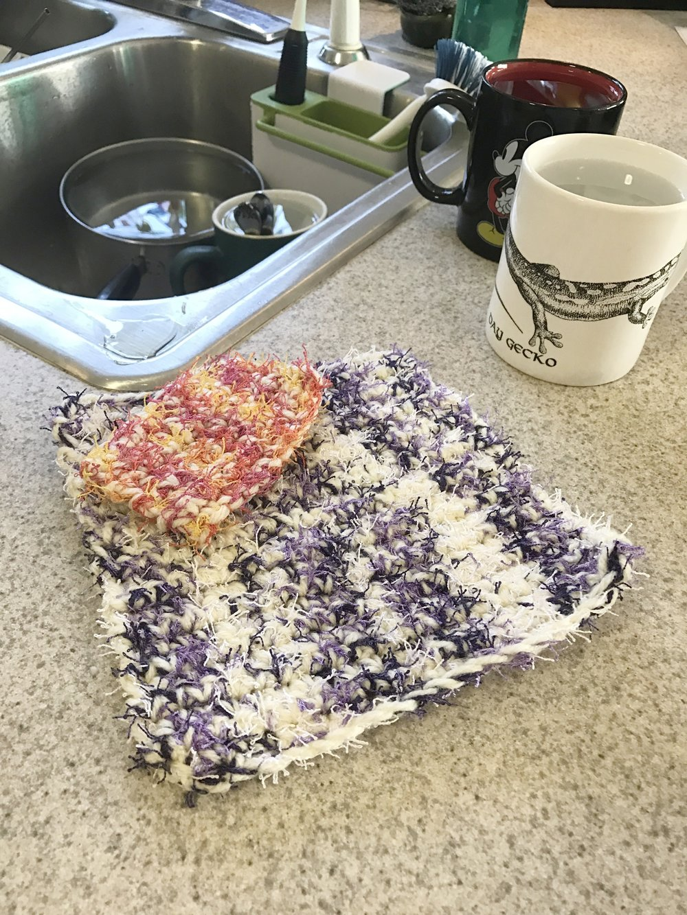 "I  love  this ""scrubby"" yarn! Crocheted with scrubby and acrylic yarn simultaneously, these cloths pack some serious scrubbing power."