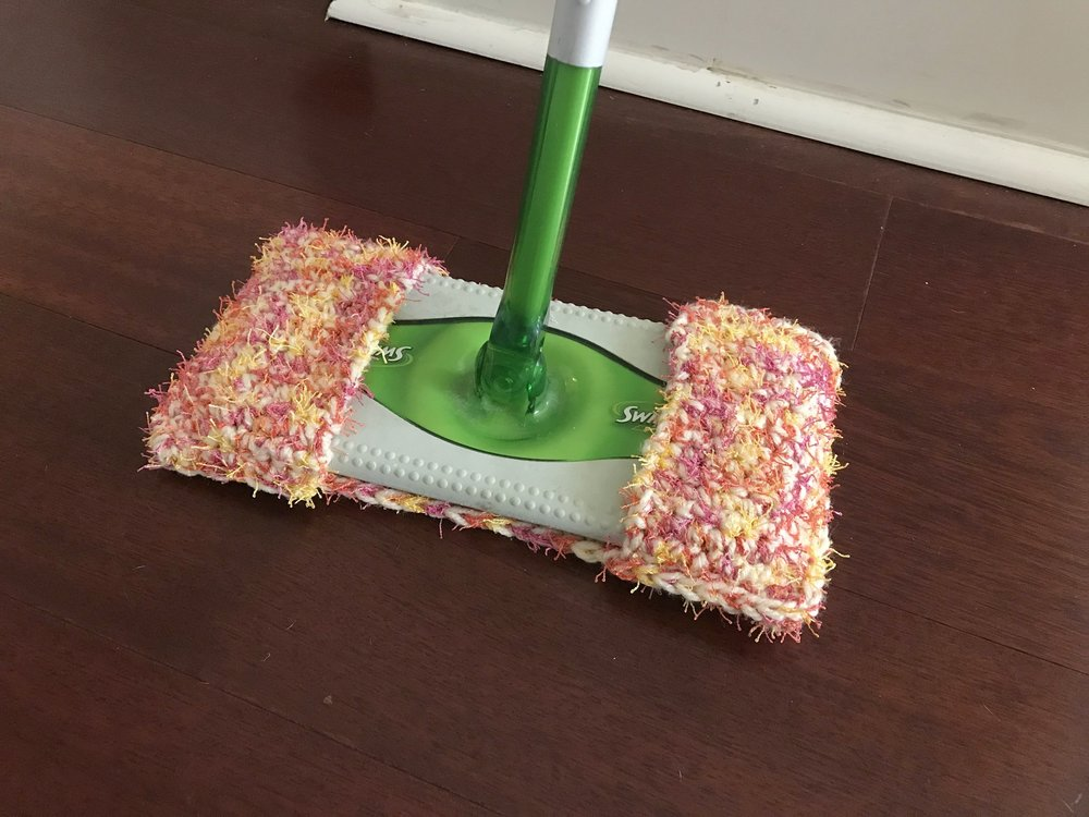 A colorful scrubby Swiffer pad. A greener way to clean, and hopefully using less elbow grease.