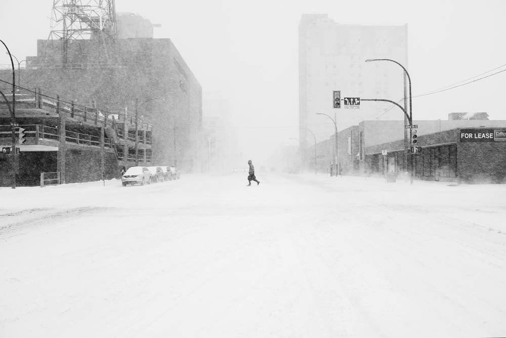 Snowy walker in Saskatoon, Canada by Brayden Elliot. From Here and Away