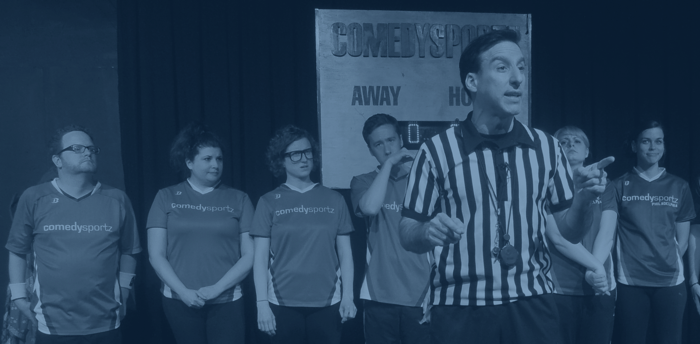 The Ref explains the rules during a ComedySportz match