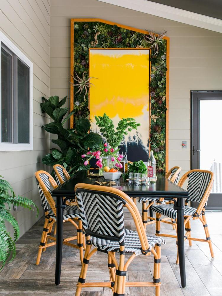 The Living Wall With Plants Takes Up Entire Back Of Screened Porch