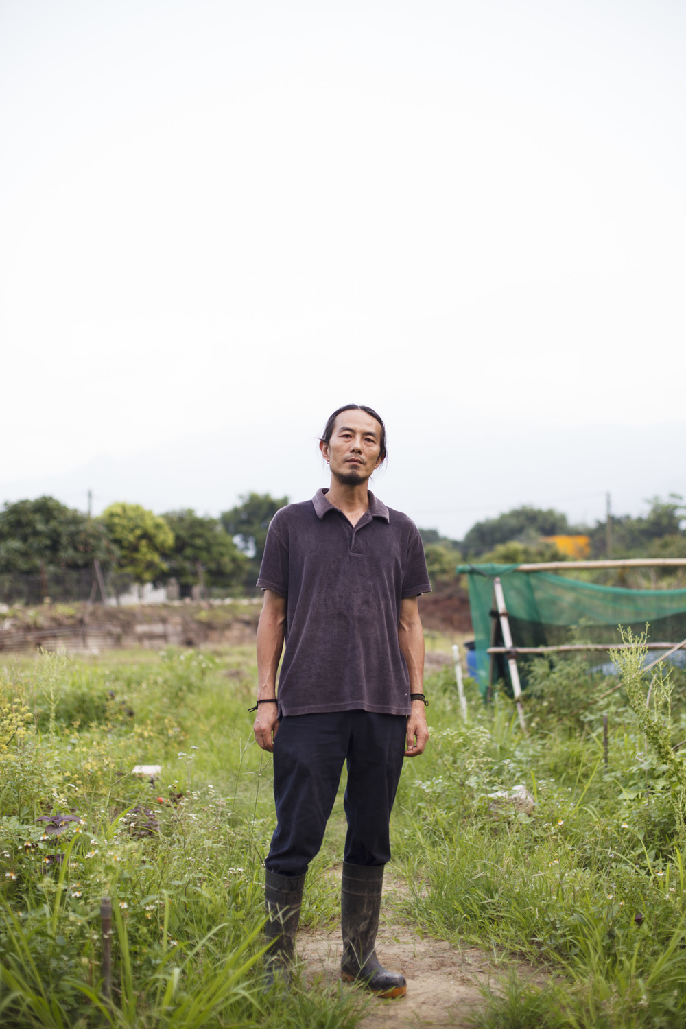 Steve Cheung, Owner of O-Veg standing in his farm in the Kam Tin in the New Territories, Hong Kong.