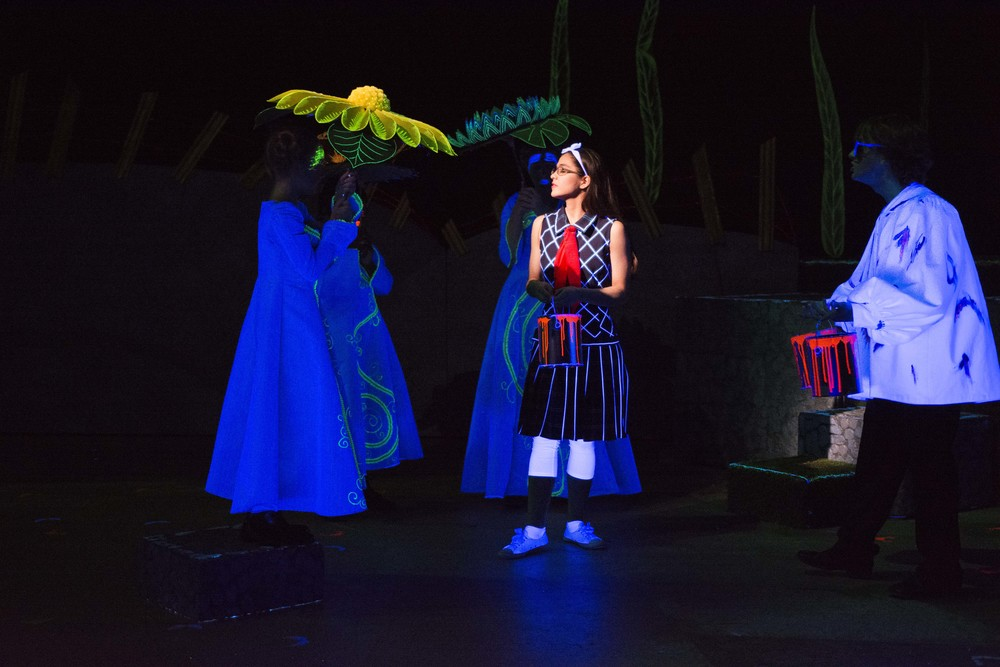 Carlie Campos Ott stars as Alice (center)