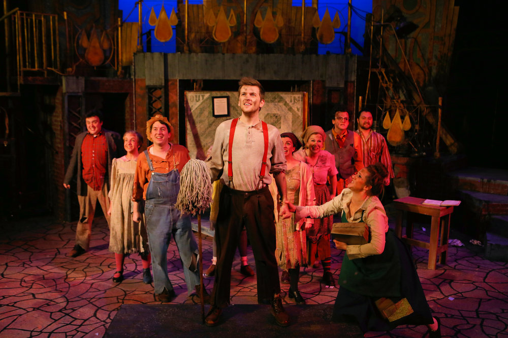 "Bobby strong (played by austin stole) and the cast of ""urinetown the musical"""