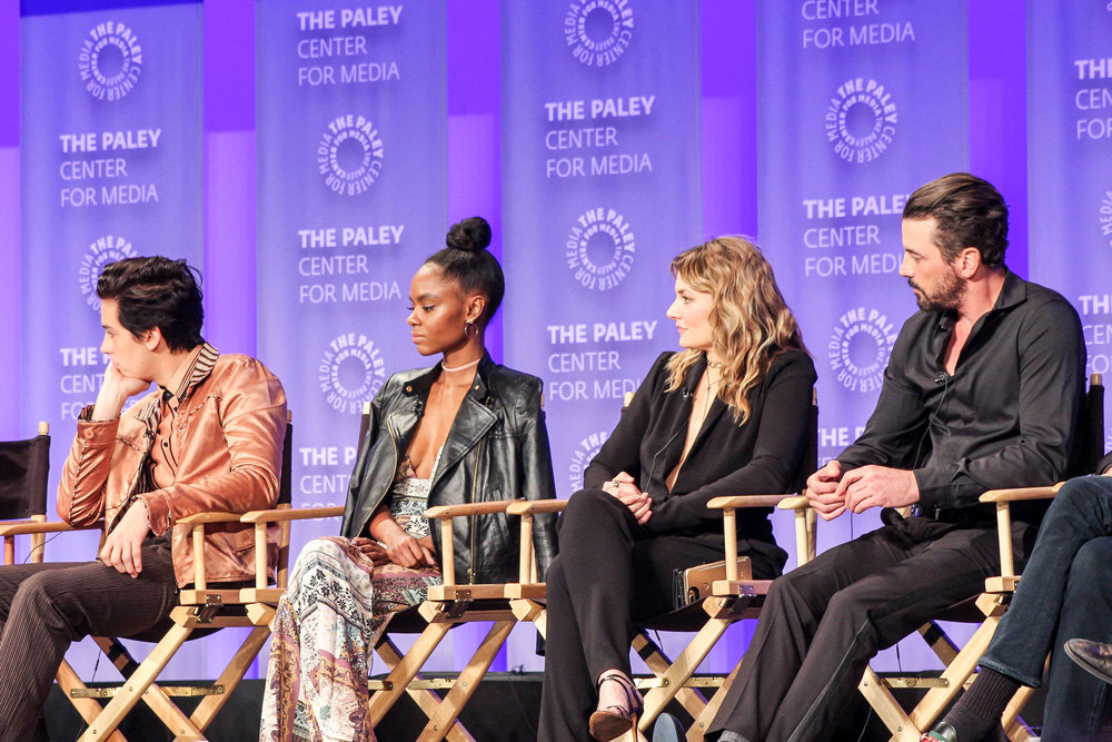 from left to right: Cole Sprouse (Jughead), Ashleigh Murray (Josie), Mӓdchen Amick (Alice), and Skeet Ulrich (FP)