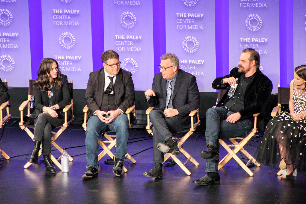 from left to right: Winona Ryder (Joyce Byers), Sean Astin (Bob Newby), Paul Reiser (Dr Sam Owens), and David Harbour (Jim Hopper)