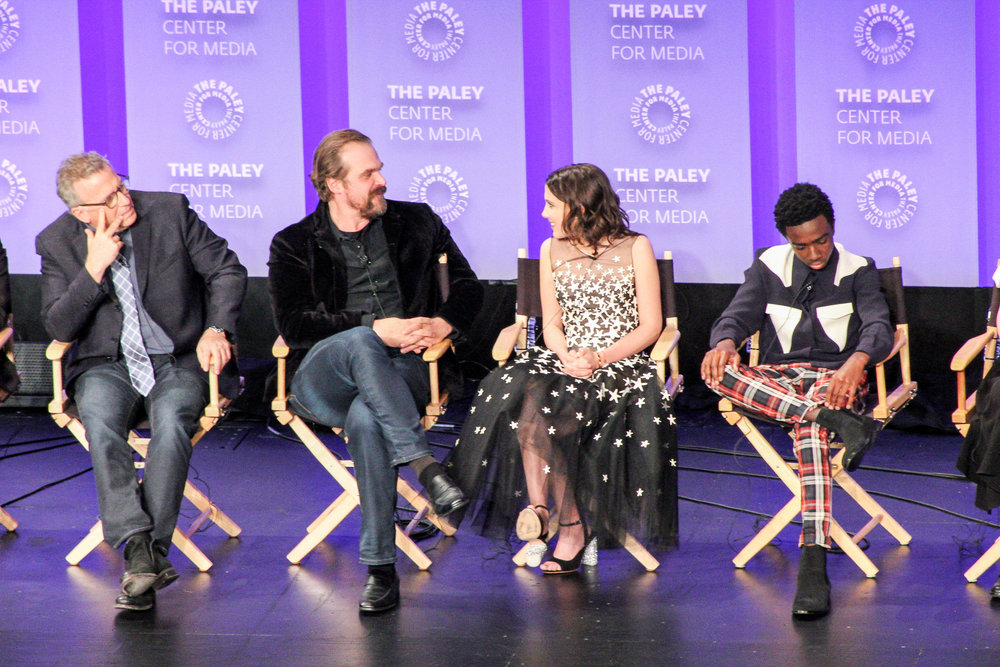 From left to right: Paul Reiser (Dr Sam Owens), David Harbour (Jim Hopper), Millie Bobby Brown (Eleven/Jane Hopper), and Caleb McLaughlin (Lucas Sinclair)