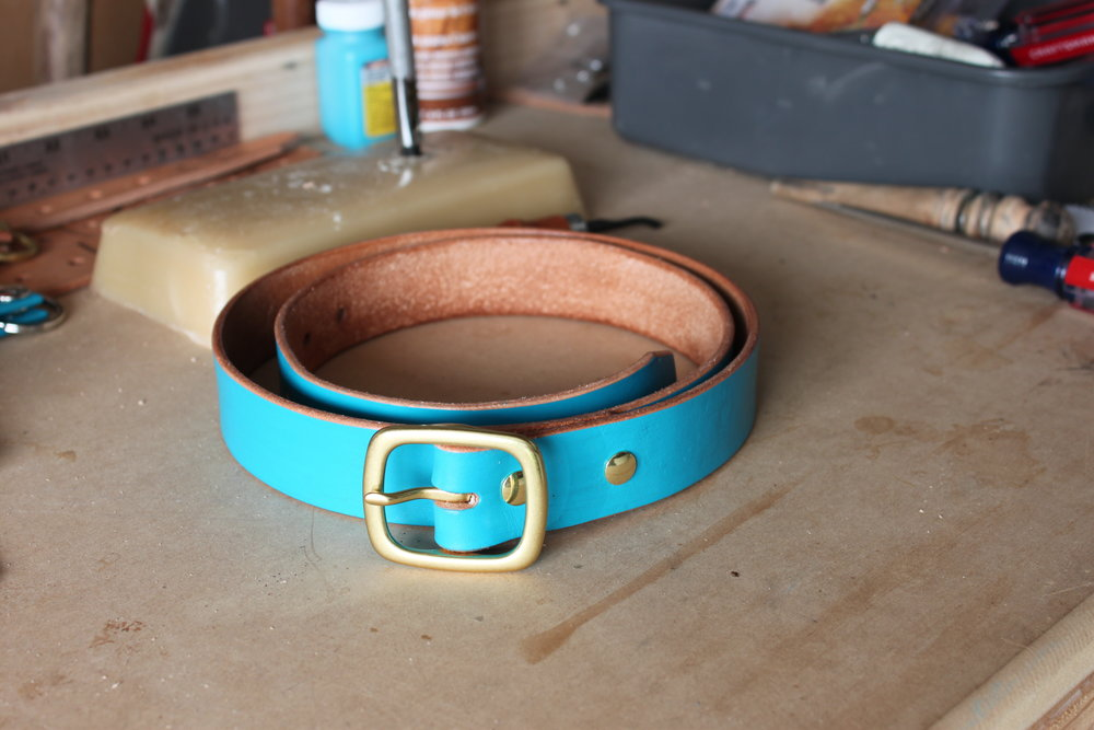 Handmade full grain leather belt. Painted by hand with solid brass buckle and solid brass chicago screws.