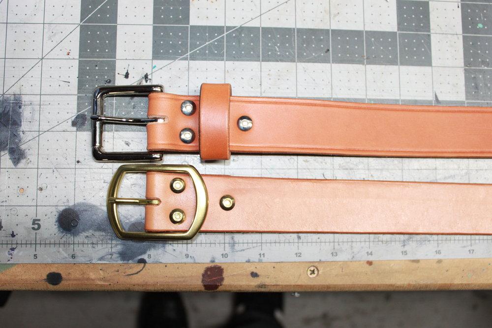 "Top: Heel buckle (Single Tongue Roller Style)  Bottom: Center Heel Buckle (Single Tongue)  Note the 1/2"" difference from heel to roller."