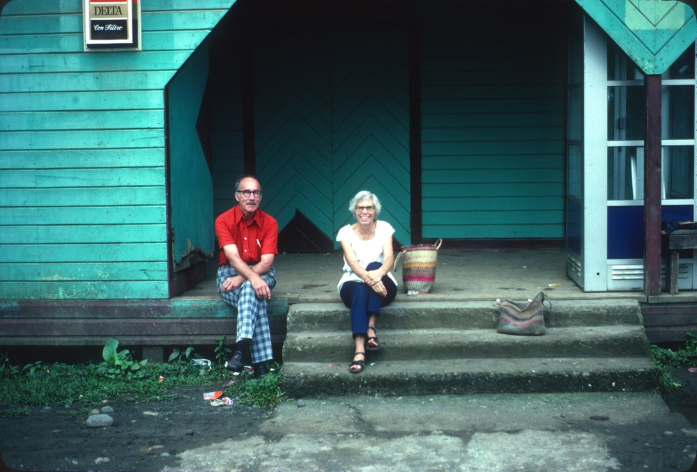 DM_001_002    Bill and Helen Stewart    Home Creek    9/1/1982    Peace Corps Volunteers Bill and Helen Stewart. They were volunteers there after I left - in 1983. I think they lived in Home Creek.    Photo taken on the steps of a community center building in Home Creek    Photographer: Dan Miller