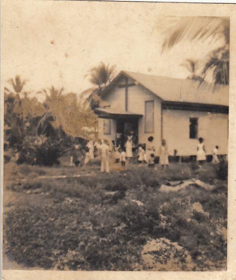 """""""Iglesia Católica Puerto Viejo""""   Puerto Viejo de Talamanca   1966   Domingo en la iglesia Católico de Puerto Viejo (lado frente)    Colaborador: Mauricio Salazar Salazar  CC_001_001"""