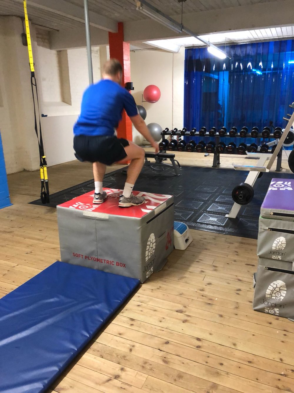 Tom then sinks into a squat from landing showing control and allowing his muscles to stay under tension longer