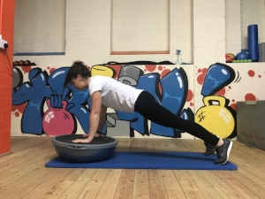 Starting position for Bosu press-up