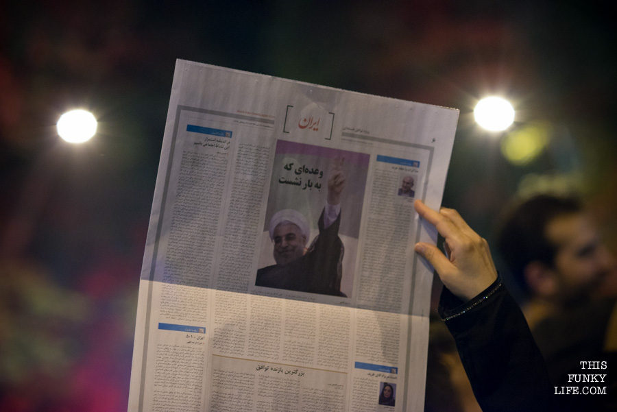 Rouhani's happy face in a newspaper