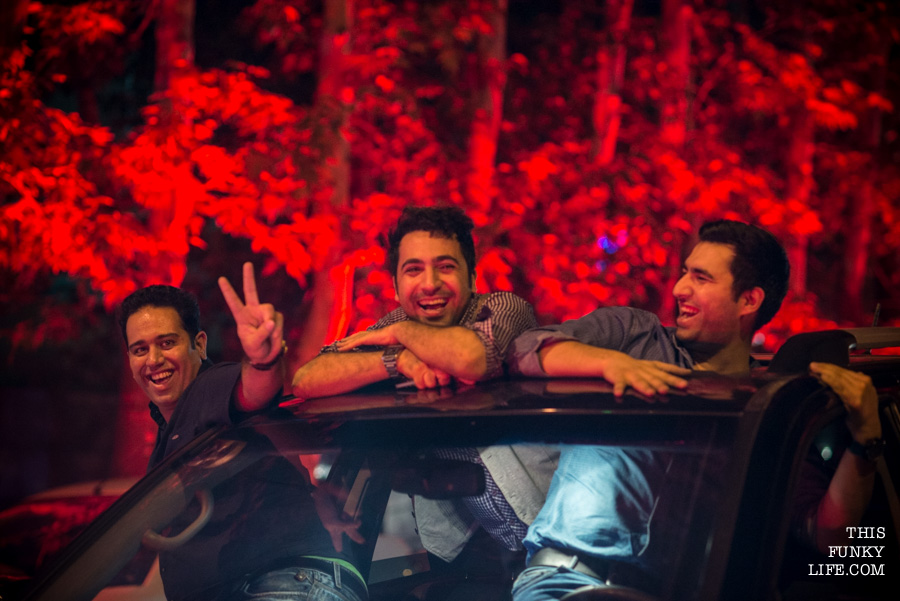 Everything had shifted to the roofs of cars. Peace signs, music, smiling faces…