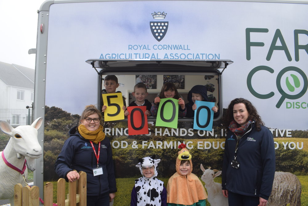 Photo credit: Steven Michell  Year 1 pupils from Pencoys Primary School join Emma Parkyn, RCAA education coordinator (left) and volunteer Kelly Parsons (right) to celebrate the 5000th Cornish primary school pupil to enjoy the Farm & Country Days On The Road project.