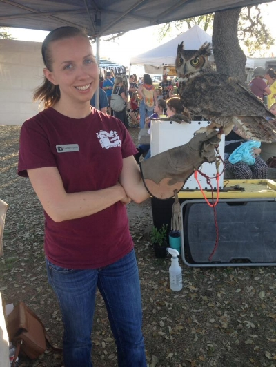 The author with Hermes, TUI's Great Horned Owl Wildlife Ambassador, at the 2018 Llano Earth Art Festival.