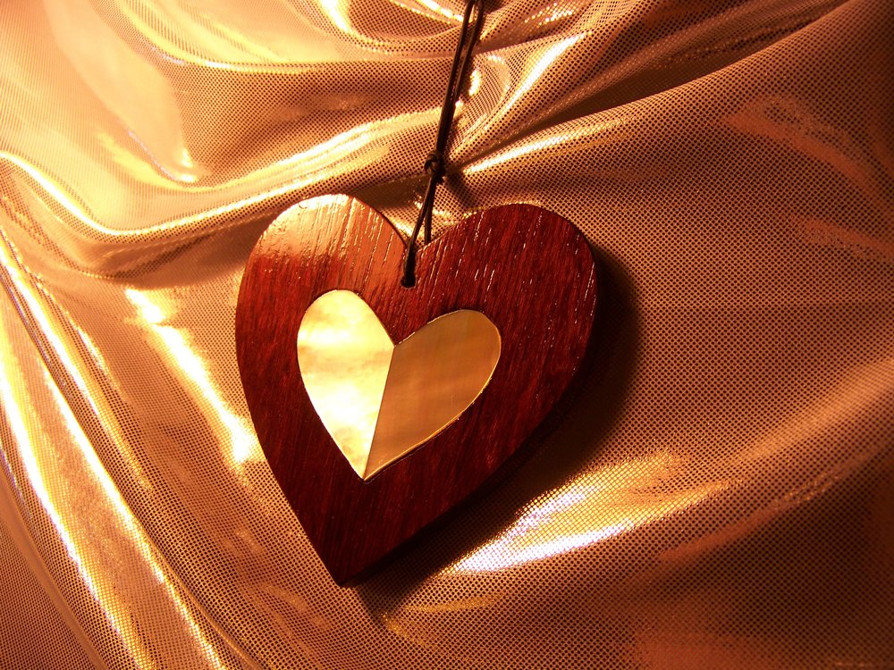 "My first heart design:  purpleheart wood heart with golden mother-of-pearl heart inlay (approx. 3"")."