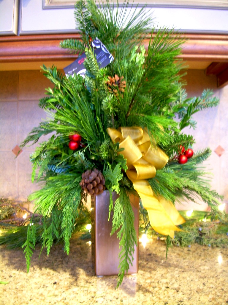 tall holiday mixed evergreen arrangement