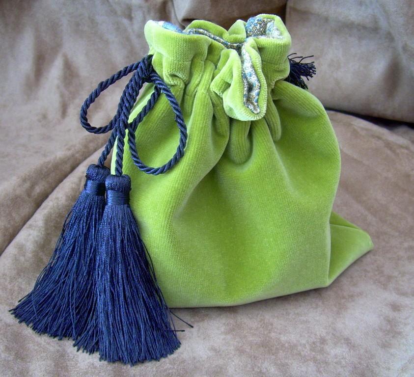 olive green velvet bag with tassel drawstring