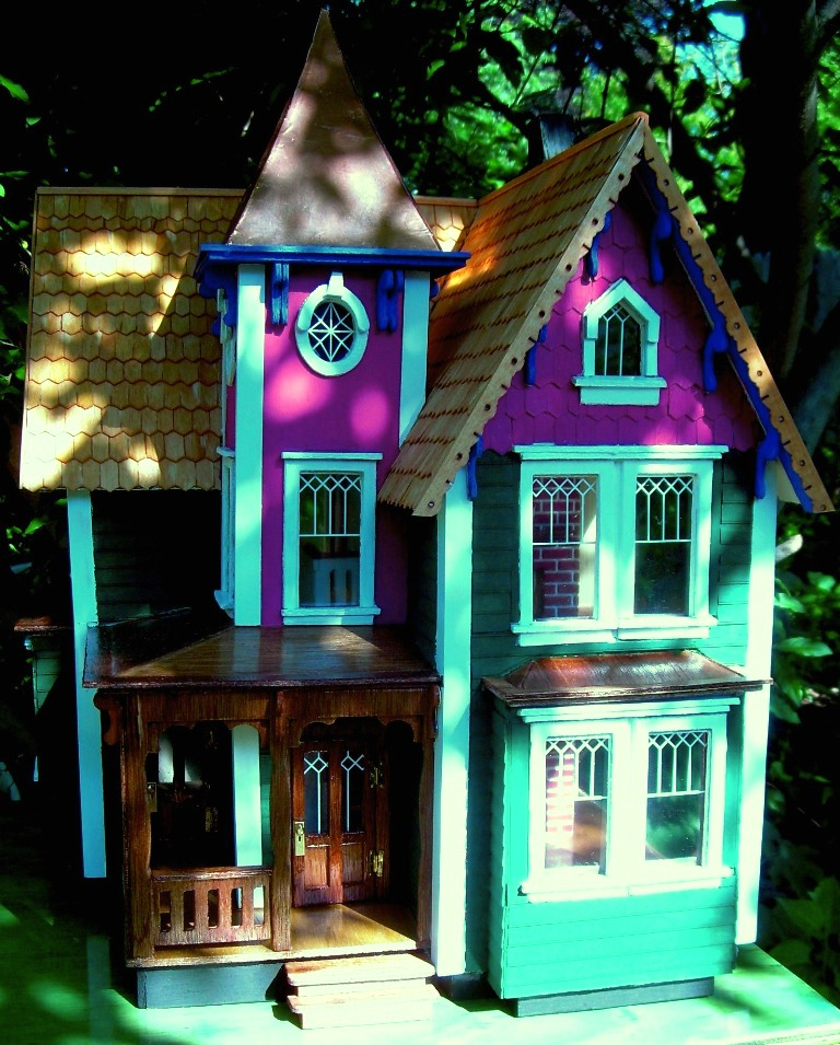 I like taking pictures of the dollhouses outside so they look like a real house and the sun coming through the windows looks terrific.