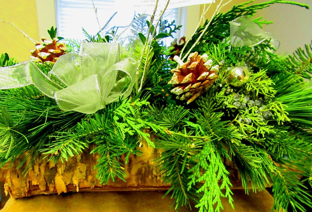 mixed evergreen centerpiece in rustic log container