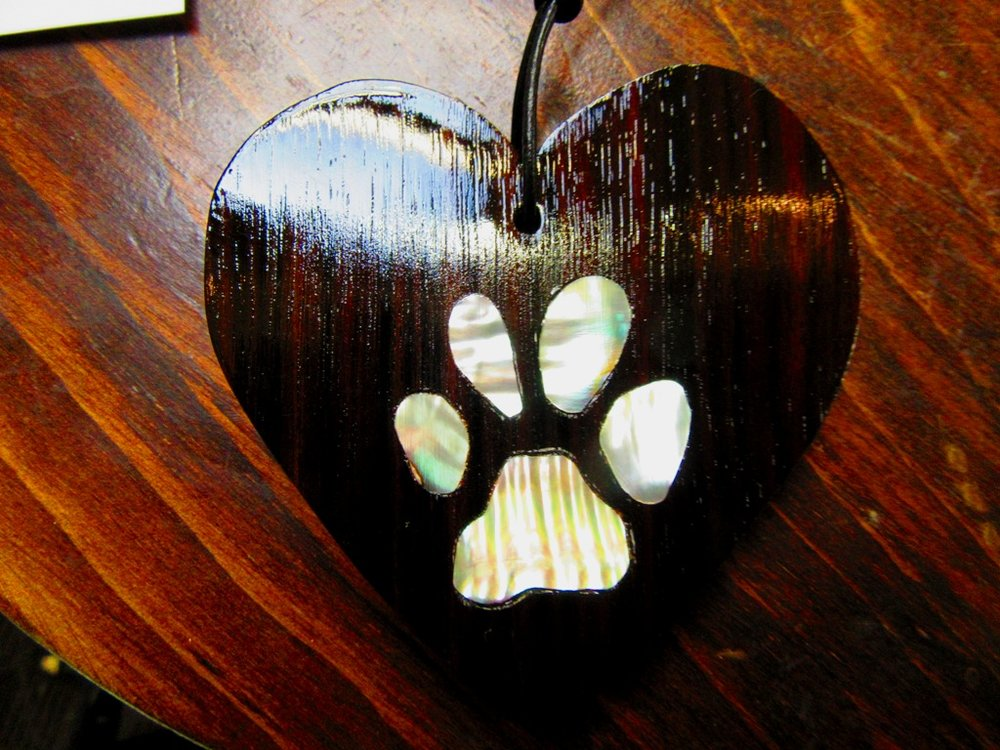 "3"" Ebony wood heart with white Abalone dog paw inlay"