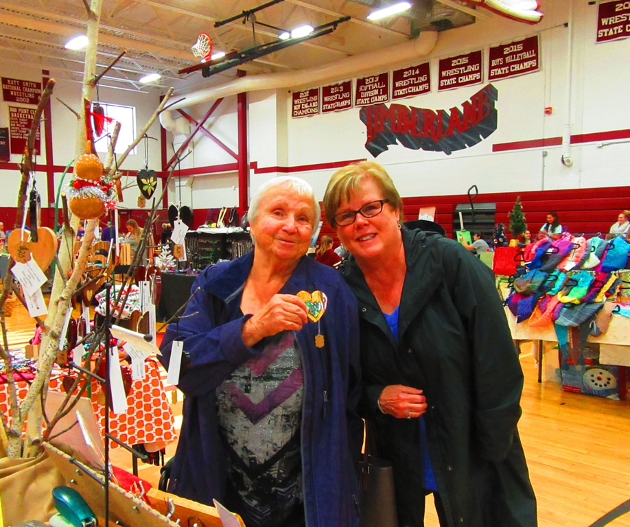 Shirley and Gail with the Spalted Tamarind heart with Abalam mosaic inlay.