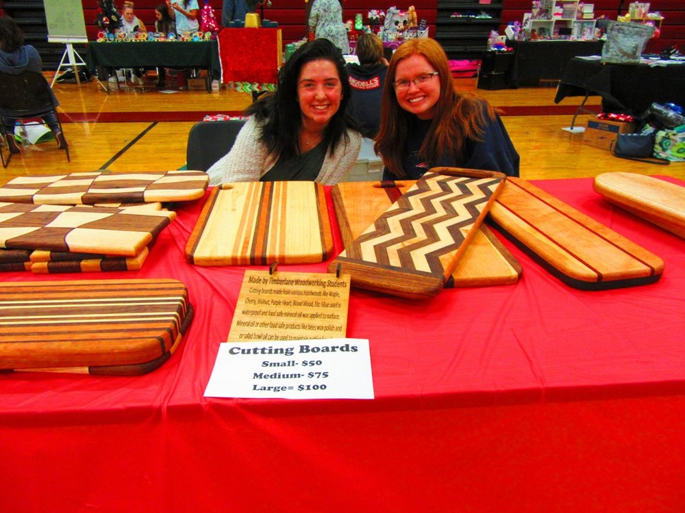 Caroline and Ellie at the Timberlane Woodworking Class Cutting Boards table