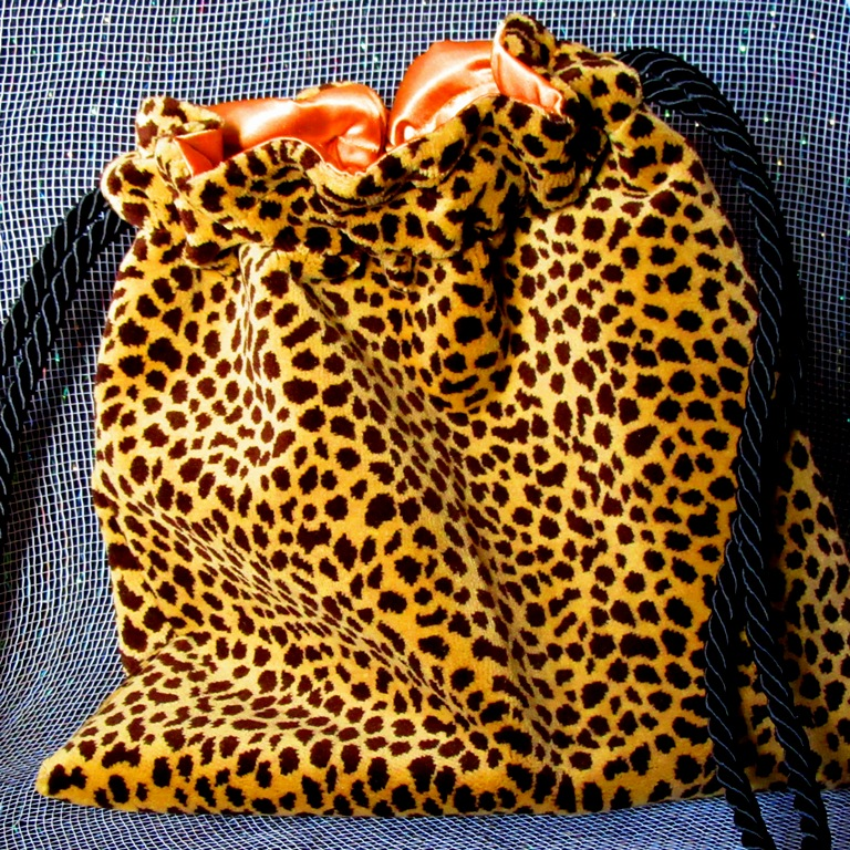 Cheetah drawstring bag with gold satin lining