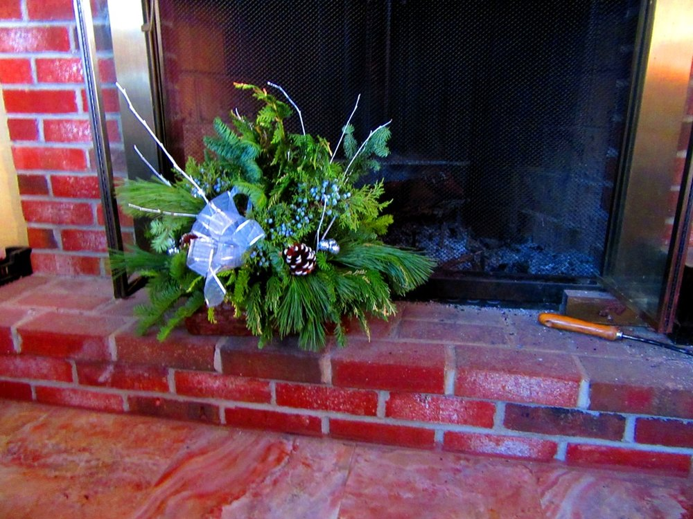 log basket in front of fireplace indoors
