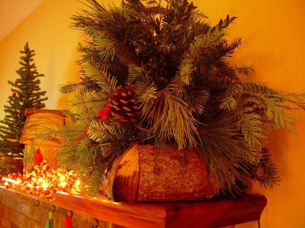 log basket on display indoors on fireplace mantle
