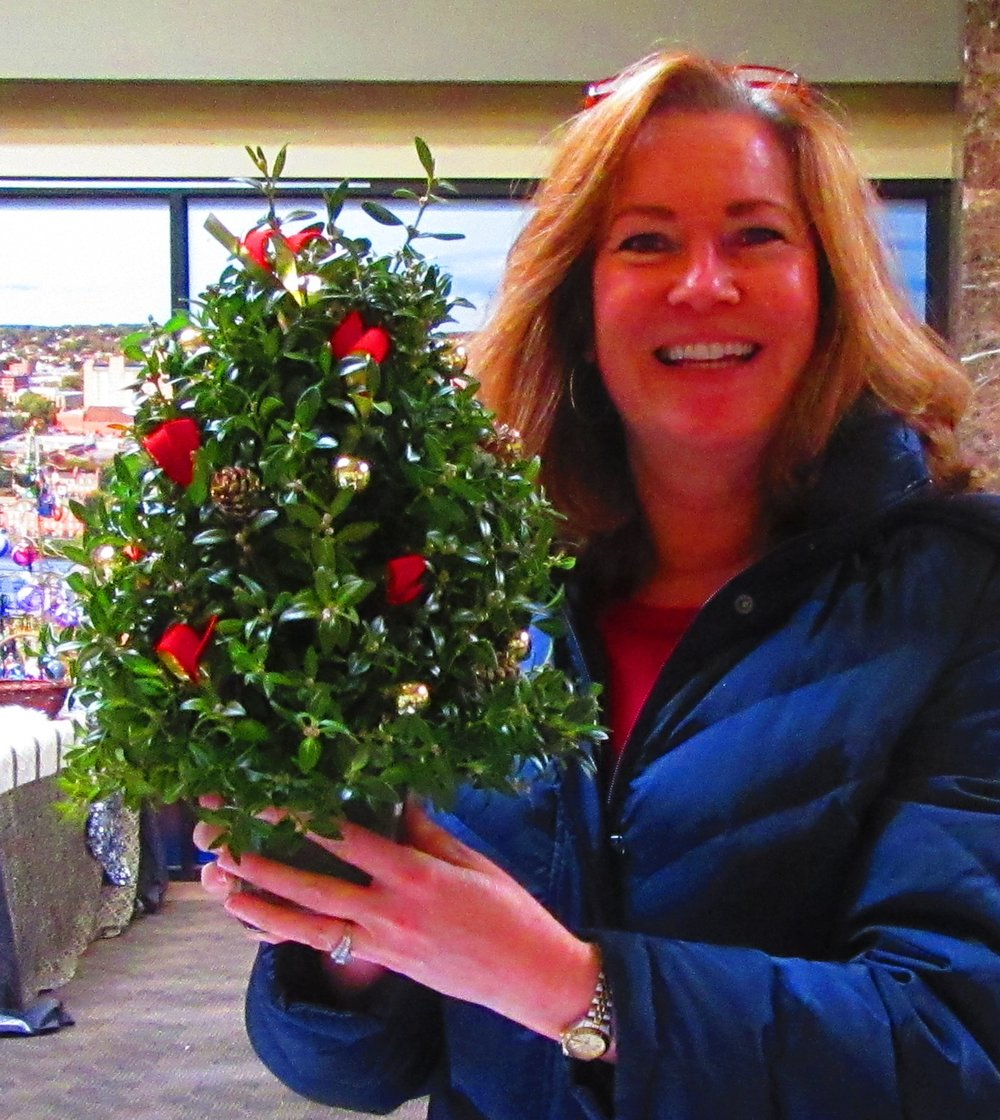 The popular boxwood tree arrangement in glass with one of my favorite customers, the beautiful Lisa, modeling it for me