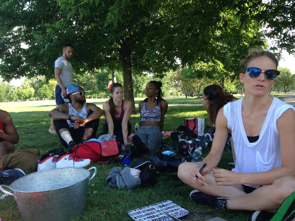 Dancers take a break and talk shop during a long day of rehearsal at Humboldt Park