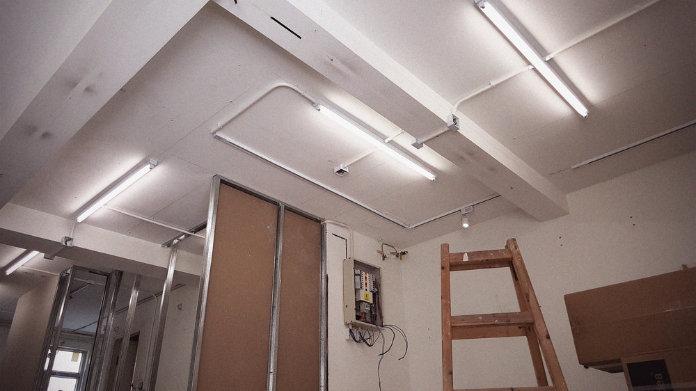 Reorganising the lighting helped us change the space from a storage unit, to a fully functioning, multi use art/design studio.