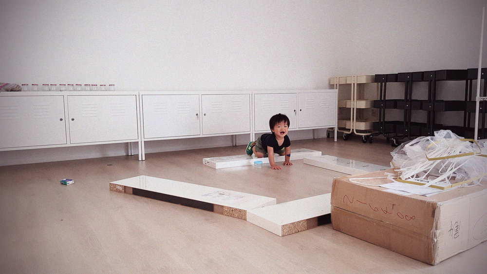 Nathen was with us every step of the way. Here he is crawling amongst flat pack furniture from IKEA.