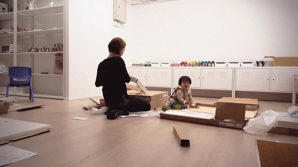 Nathen helping us assemble more furniture. HA HA.
