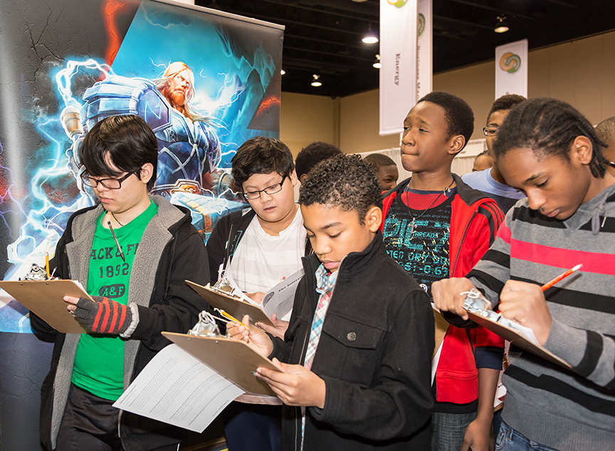 The booth for Hi-Rez Studios, an Alpharetta-based video game development studio, was a popular stop for students.