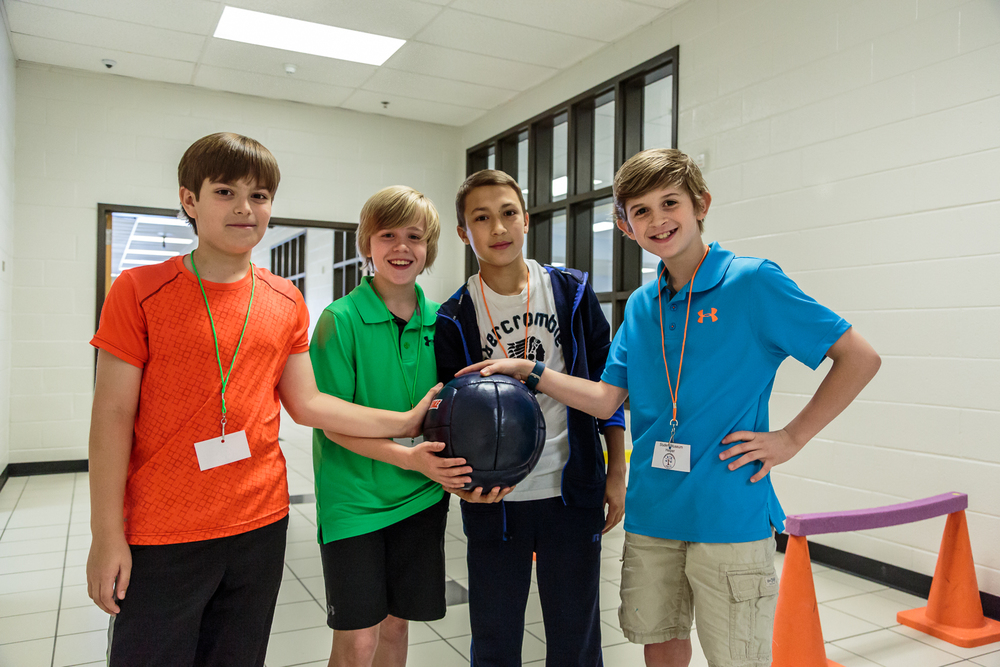 A group of 5th graders—  Andrew, Hunter, David,  and  Evan — worked together on a project to increase cardiovascular endurance.