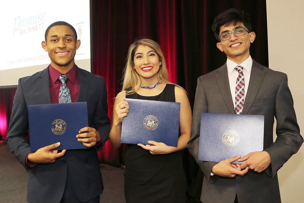 Peter Doro  of  Norcross HS,  1st runner up;  Gabriela Yalitza Ruvalcaba  of  Phoenix HS,  2nd runner up;  Aanjaney Pathak  of  Brookwood HS , 2018 CTE Student of the Year
