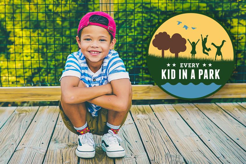 child on bridge in park_thumb.jpg
