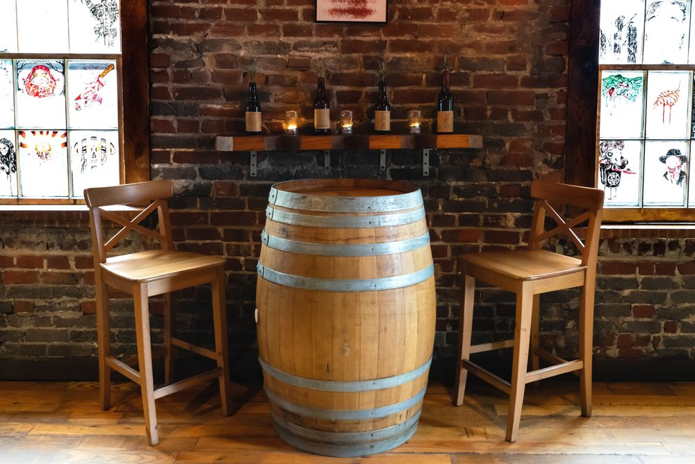 Puncheon barrel with 2 chairs by the window.