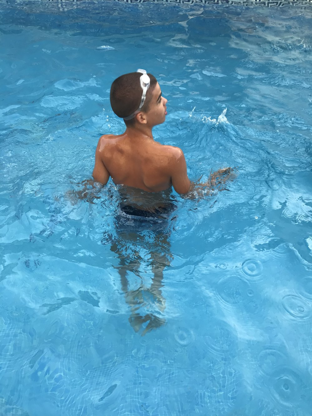 Refreshing moment in the swimming pool