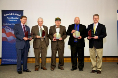 2013 Hall of Fame: Bill Milliken Jr. accepting for former governor William Milliken, Howard Tanner, Fred Wilder, Brad Jensen accepting for Huron Pines, & Dr. Tom Coon accepting for Michigan State University Extension.