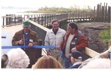 cutting the ribbon for grand-opening of Wilder River Walk