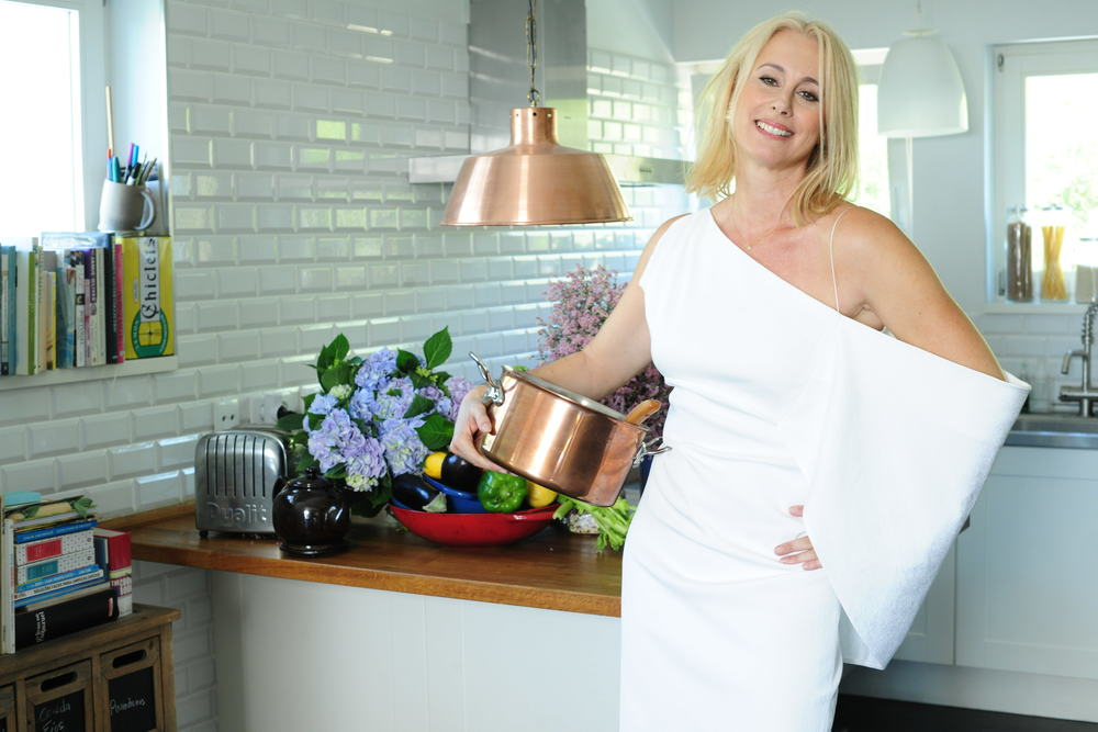 Me in my kitchen, which I love to death! My hair is a mess, (I did it myself!) but my gorgeous dress is from Tom Ford, at Fashion Clinic. P.S. I always look like this this when I'm cooking!! All white and not an apron in sight!