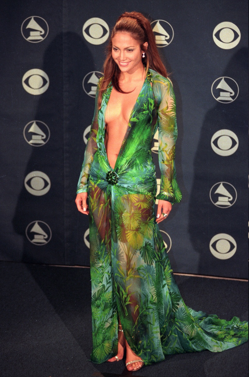 Jennifer Lopez, the year 2000, in Versace, again another memorable dress from the sexy Italian brand. Who can forget this barely-there tropical print dress?