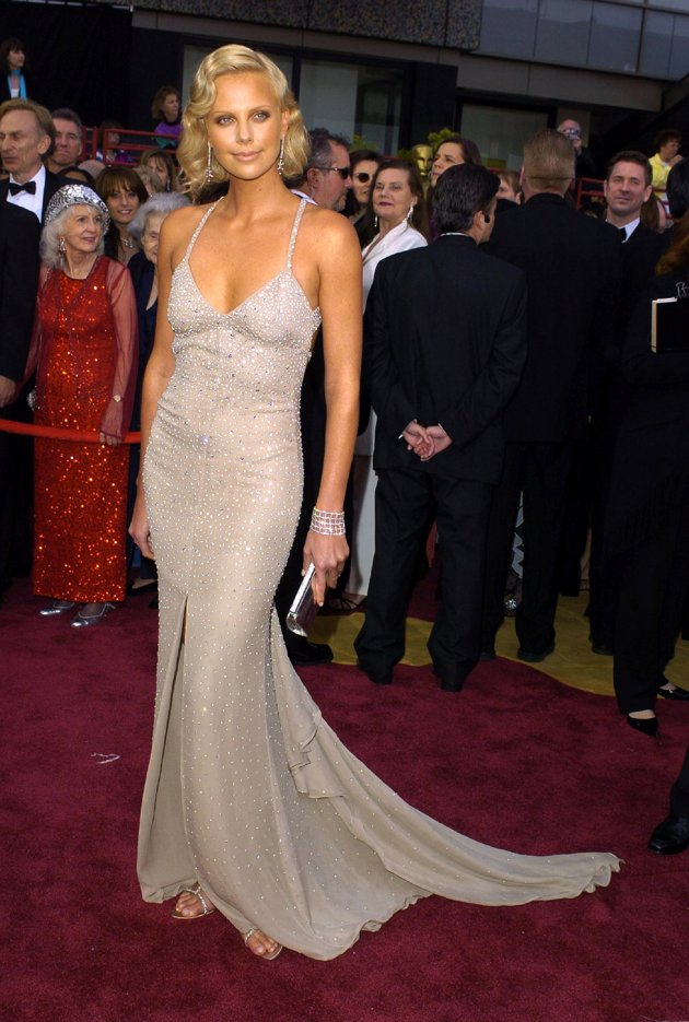 The perfectly turned out Charlize Theron in Gucci, in 2004. Very classic old school Hollywood.